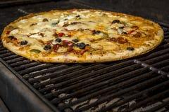 Pizza arrostita un giorno di estate Fotografie Stock Libere da Diritti