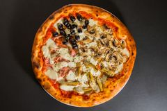 Pizza with artichokes and mushrooms top view Royalty Free Stock Photo