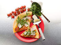 Pizza with arugula and parmesan Royalty Free Stock Photography