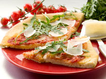 Pizza with arugula and parmesan Royalty Free Stock Photo