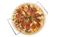 Pizza auf einem Tellersegment Stockfoto