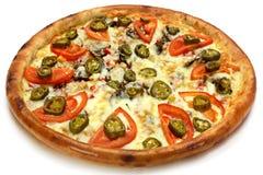 Pizza avec la tomate Photographie stock libre de droits