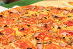Pizza. Background pizza closeup. soft focus Stock Image