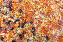 Pizza Background. Delicious traditional Italian pizza background Stock Photo