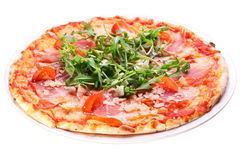 Pizza with bacon and arugula. Pizza with bacon and arugula on a white background. Clipping path stock photo