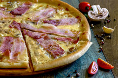 Pizza with bacon. Fresh tasty pizza with bacon Stock Images