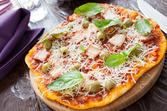 Pizza with bacon and grated parmesan cheese Royalty Free Stock Image