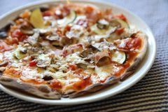 Pizza with bacon and mushroom , italian food royalty free stock photography