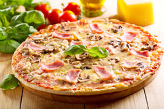 Pizza with bacon and mushrooms Royalty Free Stock Images