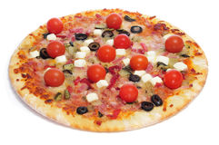 Pizza with bacon, olives, cherry tomatoes, goat cheese, green pe Royalty Free Stock Photography