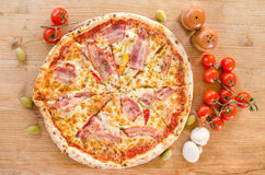 Pizza with bacon, pepperoni, melted cheese and mushrooms - Top view Stock Photography