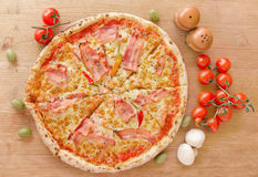 Pizza with bacon, pepperoni, melted cheese and mushrooms - Top view Stock Photo