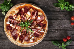 Pizza with bacon and tomato paste Stock Image