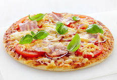Pizza with bacon and tomato Stock Photos