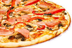 Pizza with bacon and tomatoes Royalty Free Stock Images