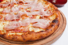 Pizza Bacon on a wood plate Stock Image