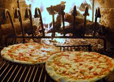 Pizza baked in a wood fireplace 1 Royalty Free Stock Image