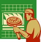 Pizza baker holding baking oven Royalty Free Stock Photos