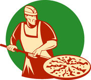 Pizza baker holding baking pan Royalty Free Stock Photo