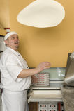 Pizza bakers. A pizza bakers at the work royalty free stock image