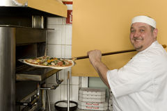 Pizza bakers Stock Images