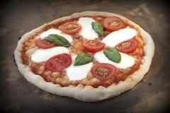 Pizza Baking. Rustic Italian Pizza Margarita in a hot stone oven. Royalty Free Stock Photo