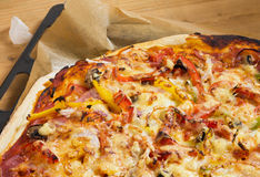 Pizza on baking sheet Stock Photos