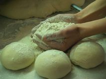 Pizza barm. Greek Pizza barm kneading with hands stock photography