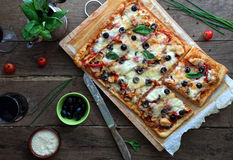 Pizza with bbq sauce. Chicken and bacon on a rustic table Stock Image