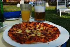 Pizza at beach Royalty Free Stock Images