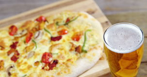 Pizza with beer stock video