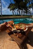 Pizza and beer by the poolside in Hawaii. Pizza by the poolside in Hawaii stock photography