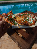 Pizza and beer by the poolside in Hawaii. Pizza by the poolside in Hawaii Stock Photo