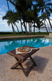 Pizza and beer by the poolside in Hawaii. Pizza by the poolside in Hawaii stock image