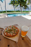 Pizza and beer by the poolside in Hawaii. In Kihei royalty free stock photo