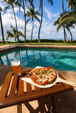 Pizza and beer by the poolside in Hawaii. In Kihei royalty free stock images