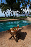 Pizza and beer by the poolside in Hawaii Royalty Free Stock Photography
