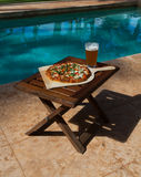Pizza and beer by the poolside in Hawaii Royalty Free Stock Photo