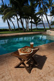 Pizza and beer by the poolside in Hawaii. In Kihei stock photo
