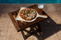 Pizza and beer by the poolside in Hawaii. In Kihei Stock Images