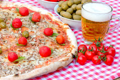 Pizza and beer on table - delicious meal Royalty Free Stock Photos