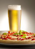 Pizza and beer Stock Image