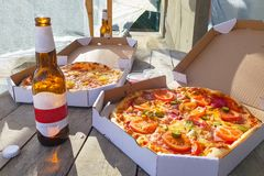 Pizza with beers. On the summer terrace stock photos