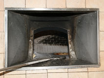 Pizza being baked in a wood fire brick oven in a restaurant Royalty Free Stock Photos