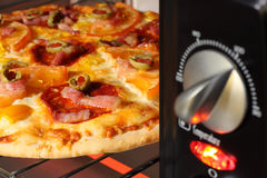 Pizza being cooked  in oven Stock Photos