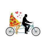 Pizza on bicycle. Lovers of cycling. Man rolls a slice of pizza Royalty Free Stock Photos