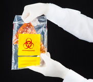 Pizza in biohazard plastic bag. Royalty Free Stock Photo