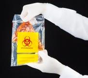 Pizza in biohazard plastic bag. Royalty Free Stock Photo