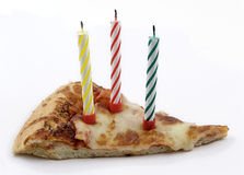 Pizza birthday with clipping path. Slice of cheese pizza with three colored birthday candles isolated on white background. Contains embedded clipping path Stock Photo