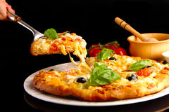 Pizza in black Stock Images